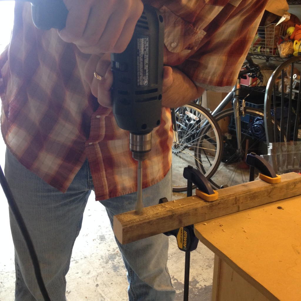 "Drill a 5/8"" hole through two of the 16"" lengths of 1.5"" x 1.5"" pole. We drilled these holes 1.5"" in from one end."