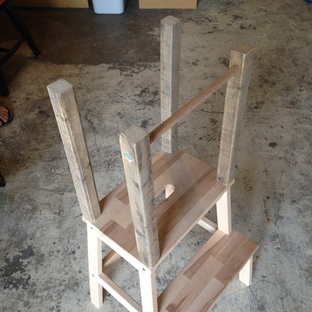 "With the uprights attached to the platform, we then screwed the platform back onto the stool and ran the dowel through the 5/8"" holes."