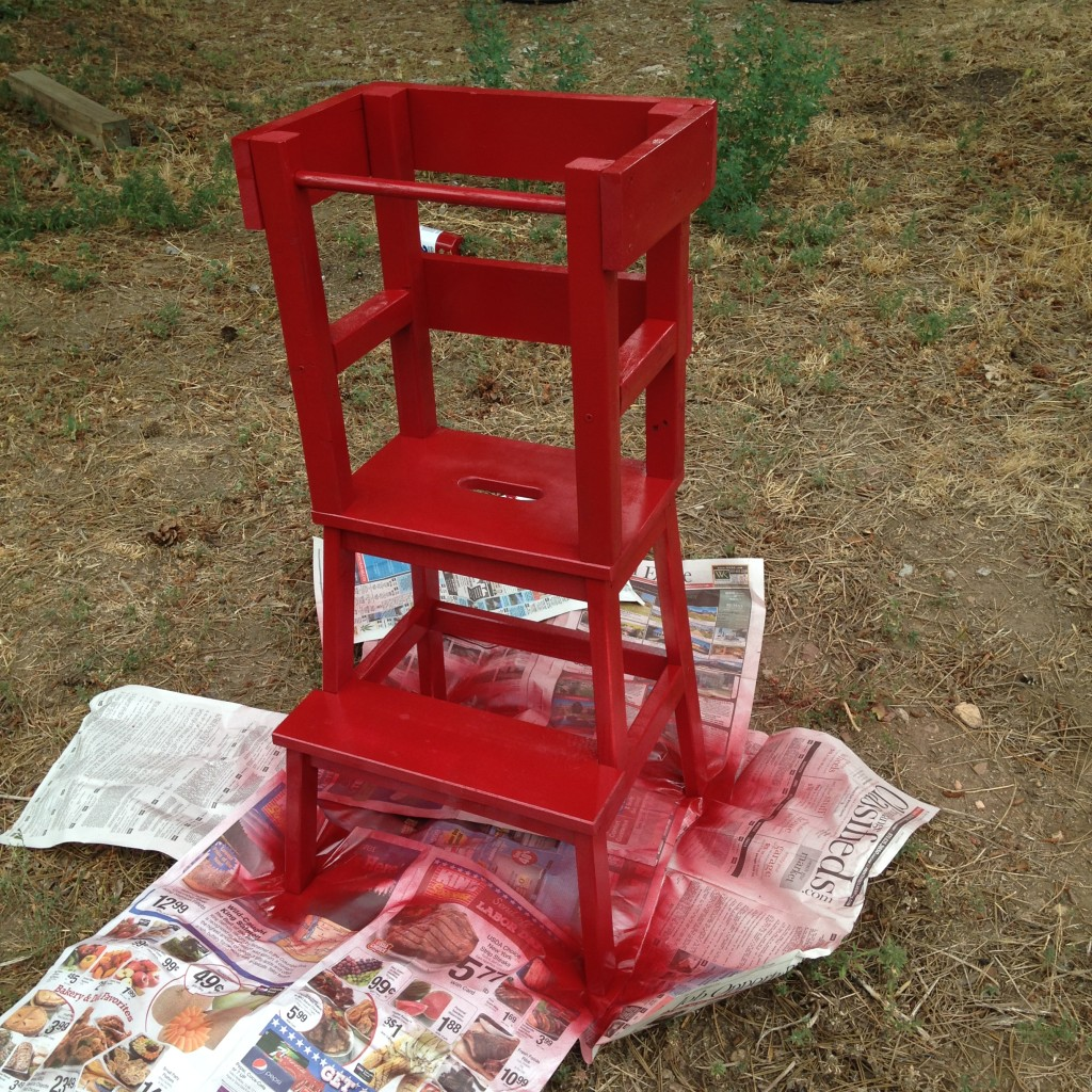 It took a little less than two cans of Rustoleum spray paint to paint the tower red. The spray paint we chose had primer in it so it wouldn't just soak into the wood.