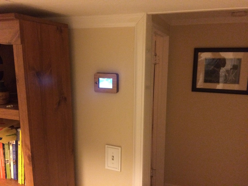 The iPhone 4 frame mounted in a high traffic area, providing an easy readout of house status.