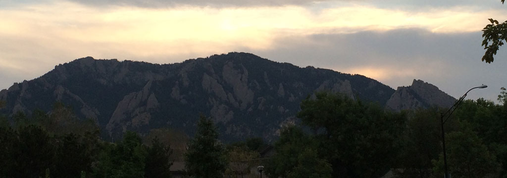 A sunset picture of the Boulder Flatirons from our backyard. Notice how the mountains become backlit once the sun sets.